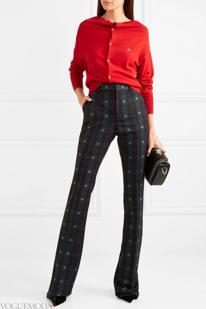 красный кардиган и высокие брюки
